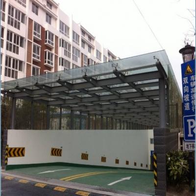 钢结构公司停车出入口钢化夹胶玻璃雨棚